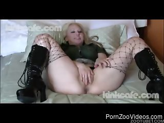 Crazy zoophile MILF fucks with a small black dog